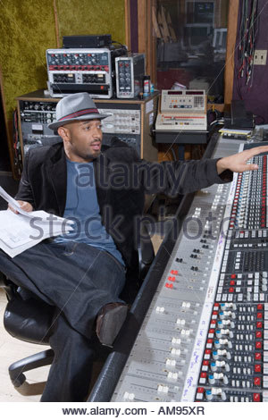 Music producer with sound equipment - Stock Photo