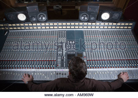 Producer adjusting sound equipment - Stock Photo