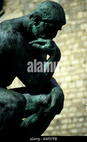 The Thinker by Auguste Rodin at the Musee Rodin Paris - Stock Photo