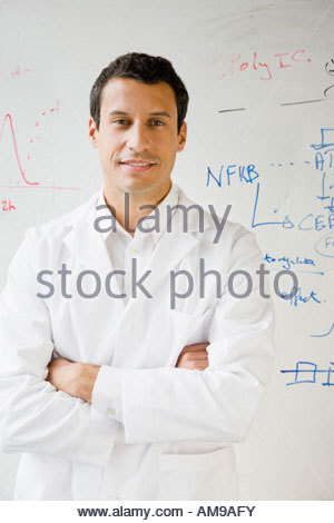 Male scientist in front of whiteboard - Stock Photo