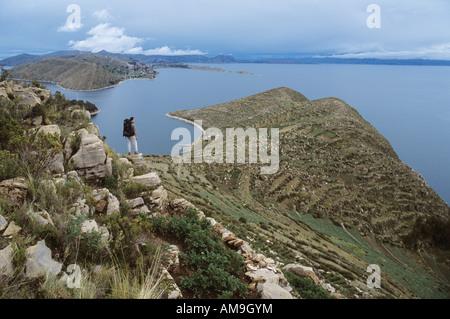 Backpacker on Isla del Sol, Lake Titicaca, Bolivia - Stock Photo