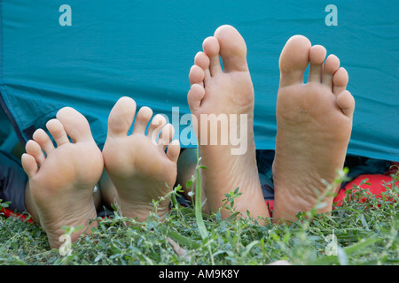 ... Two peopleu0027s feet sticking out of tent door. - Stock Photo & Couple feet sticking out of bed covers Stock Photo: 130655162 - Alamy