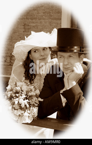 A sepia photograph of a newly married bride and groom seen here in a black and white photograph. - Stock Photo