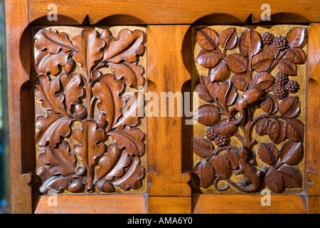 Wales Cardiff Castle Lord Butes bedroom carved panels on rear of door - Stock Photo