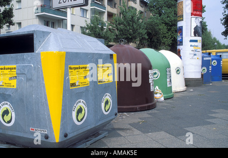 Germany Berlin a row of curbside recycling containers for packaging brown green and white glass and paper - Stock Photo