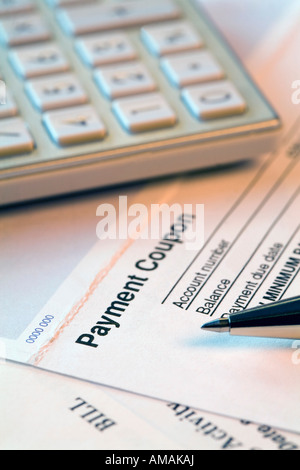 Bills with a pen and a calculator - Stock Photo