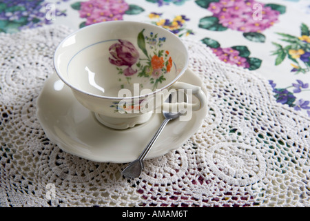 A cup and saucer on a table - Stock Photo