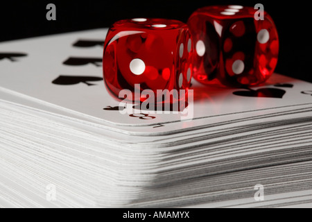 Two dice and a pack of playing cards - Stock Photo