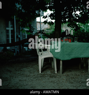 A table and chairs in the garden