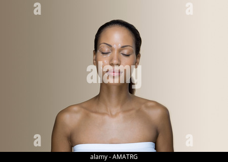 A woman with cosmetic surgery pen marks on her face - Stock Photo