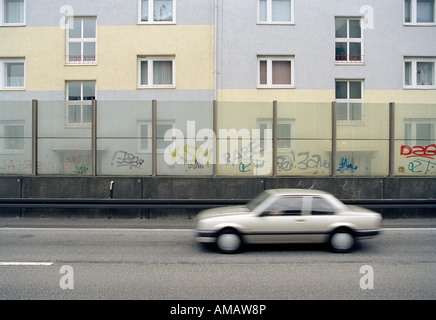 A car passing an apartment building - Stock Photo