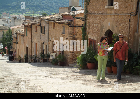 tourists on set of steps Via Crucis Way of the Cross in Pollenca town inland Mallorca Balearic Islands Spain European - Stock Photo