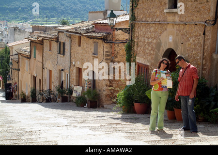 tourists on set of steps Way of the Cross in Pollenca town inland Mallorca Balearic Islands Spain European - Stock Photo