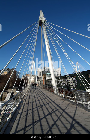 London Golden Jubilee footbridge one of two new pedestrian only River Thames crossings each side of Hungerford railway - Stock Photo