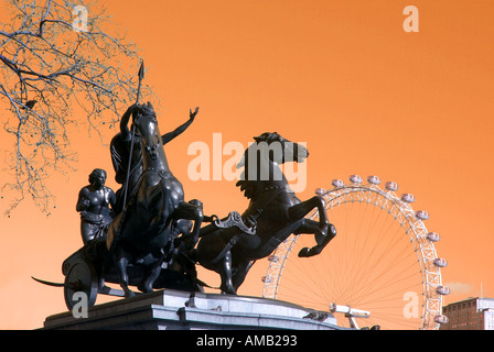 Bronze statue of Queen Boudicca and horse chariot with part of the London eye ferris wheel manipulated colour - Stock Photo
