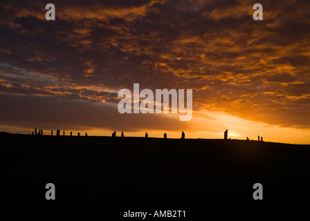 dh  RING OF BRODGAR ORKNEY Neolithic standing stone ring orange and grey sunset cloudy dusk sky - Stock Photo