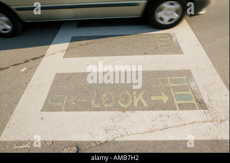 Look marking on the road at a zebra crossing USA August 2006 - Stock Photo