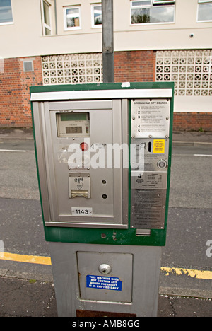 a parking meter in the uk next to the roadside in birmingham - Stock Photo