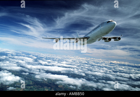 Airbus A340 above the clouds - Stock Photo