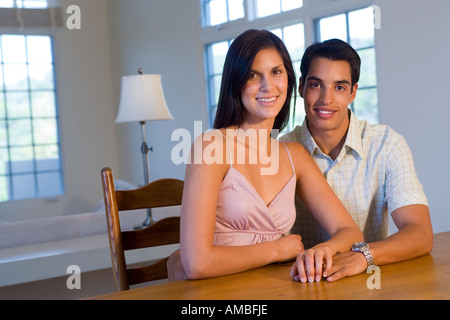 portrait of young hispanic couple at home - Stock Photo