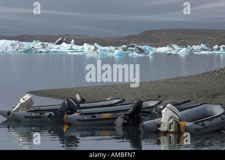 Zodiac boats lying on the beach - Stock Photo