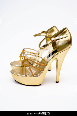 Retro gold high heels platform shoes - Stock Photo