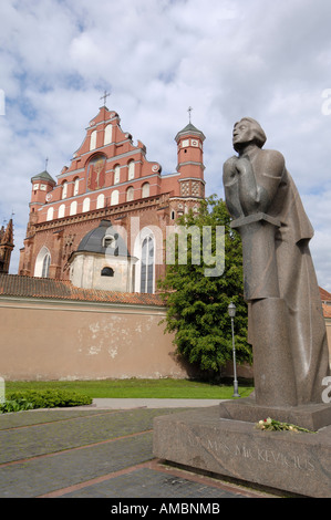 Statue of Adam Mickiewicz with Bernardine Church and Monastery in the background, Vilnius, Lithuania - Stock Photo