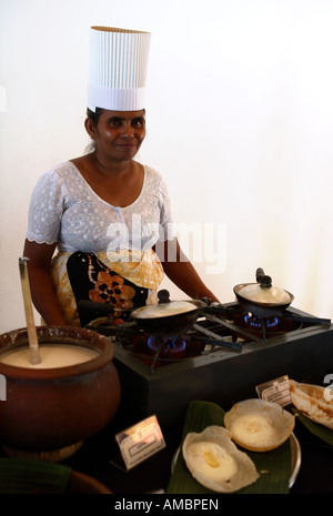 A chef in a Sri Lankan hotel making egg hoppers a crepe shell with an egg in it which is a traditional Sri Lankan - Stock Photo