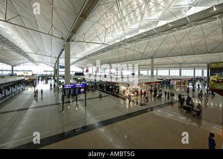 Hong Kong's Chek Lap Kok Airport Departure Terminal - Stock Photo