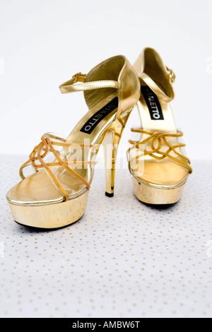 Retro style gold 'platform' shoes - Stock Photo