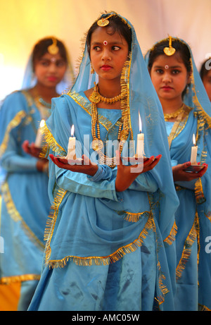 India, Bodhgaya, young girls performing a cultural dance - Stock Photo