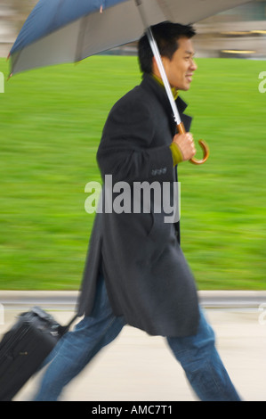 Man Walking Outdoors, With Umbrella - Stock Photo