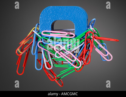 Alnico Horseshoe Magnet and Paper Clips - Stock Photo