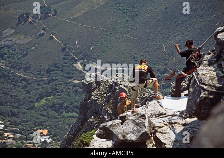 CAPE TOWN SOUTH AFRICA October Man abseiling from the top of Table Mountain just starting the descent - Stock Photo