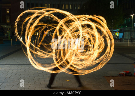 Street Performing Swinging Torches, Cathedral Square, Christchurch, New Zealand - Stock Photo