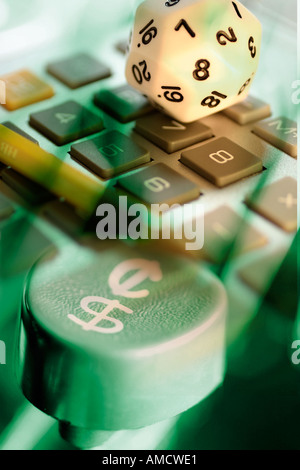 Dice and Calculator with Typewriter Key - Stock Photo