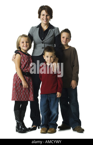 Woman with three children smiling - Stock Photo