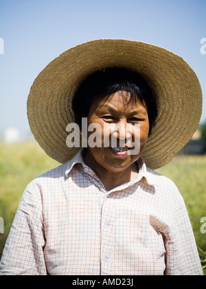 Woman with straw hat in field outdoors - Stock Photo