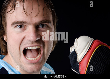 Goalkeeper after holding a ball Studio picture - Stock Photo