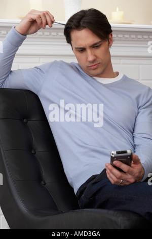 Man Using Digital Organizer - Stock Photo