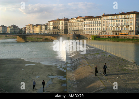 A dam across the river Arno in central Florence Tuscany Italy 2004 - Stock Photo