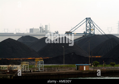 Coal Piled in Heaps on the Quayside Port of Dunkirk Northern France EU - Stock Photo