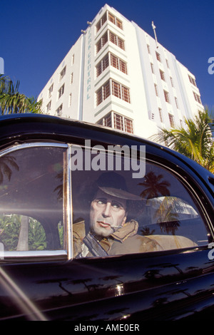 USA FLORIDA MIAMI A wax dummy of Humphrey Bogart in a car in front of an Art Deco Hotel in Miami Beach Florida - Stock Photo