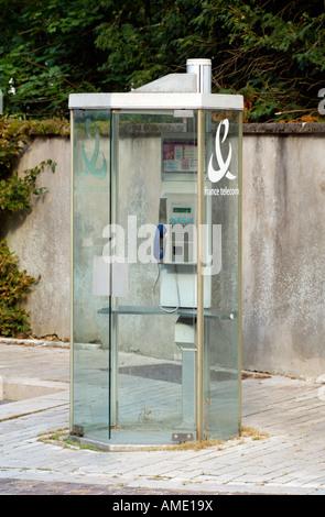 Public Telephone Box France Telecom Company Glass Phone Kiosk - Stock Photo