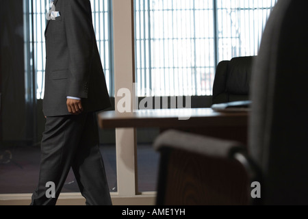 A Business man walking in an office. - Stock Photo