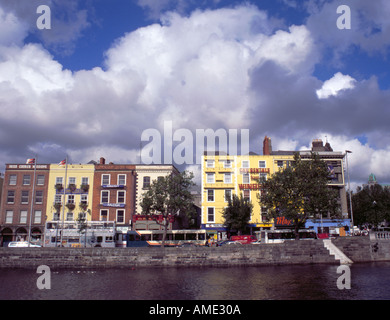Brightly painted picturesque buildings on Bachelor's Walk, seen over River Liffey from Aston Quay, Dublin, Eire - Stock Photo