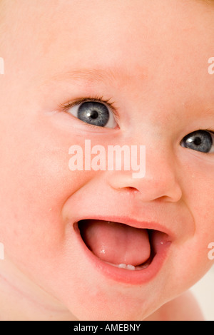 Baby Showing Her First Teeth - Stock Photo
