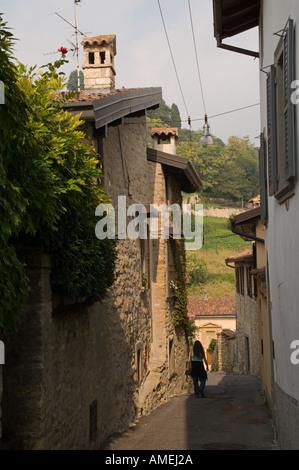 Street in old San Vigilio hill area of Bergamo Italy leading down towards Borgo Canale - Stock Photo