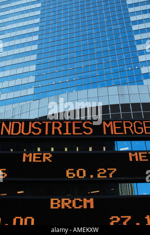 Times Square News and Financial Ticker - Stock Photo