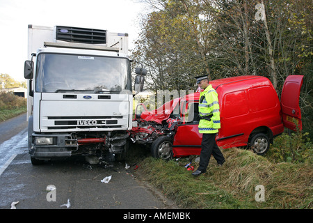 Road traffic crash between a lorry and a red van on minor road in Aberdeenshire, Scotland, with Grampian Traffic - Stock Photo